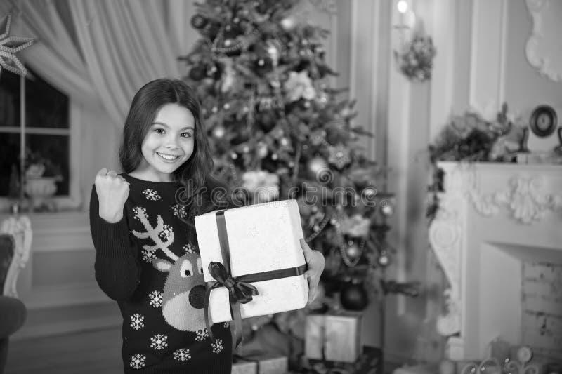 Little child girl likes xmas present. Christmas. Kid enjoy the holiday. Happy new year. small happy girl at christmas. The morning before Xmas. New year stock photos