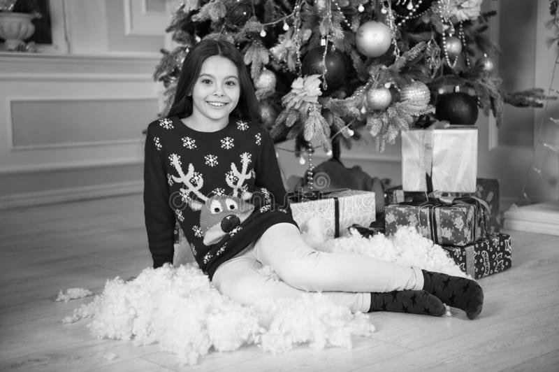 Little child girl likes xmas present. Christmas. Kid enjoy the holiday. Happy new year. small happy girl at christmas. The morning before Xmas. New year royalty free stock photography