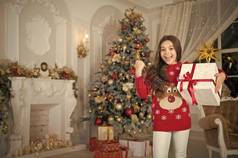 Little child girl likes xmas present. Christmas. Kid enjoy the holiday. Happy new year. small happy girl at christmas stock images