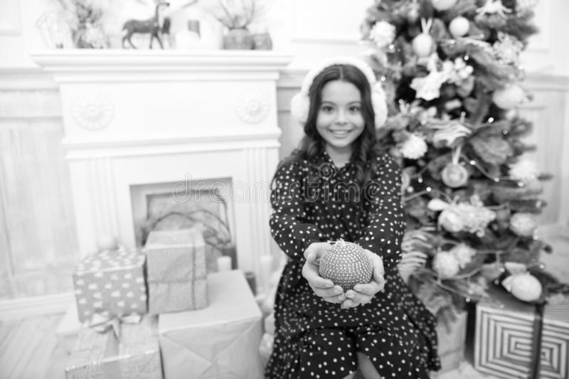 Little child girl likes xmas present. Christmas. Kid enjoy the holiday. Happy new year. small happy girl at christmas. The morning before Xmas. New year royalty free stock images