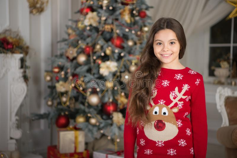 Little child girl likes xmas present. Happy new year. small happy girl at christmas. Christmas. Kid enjoy the holiday. The morning before Xmas. New year stock photo