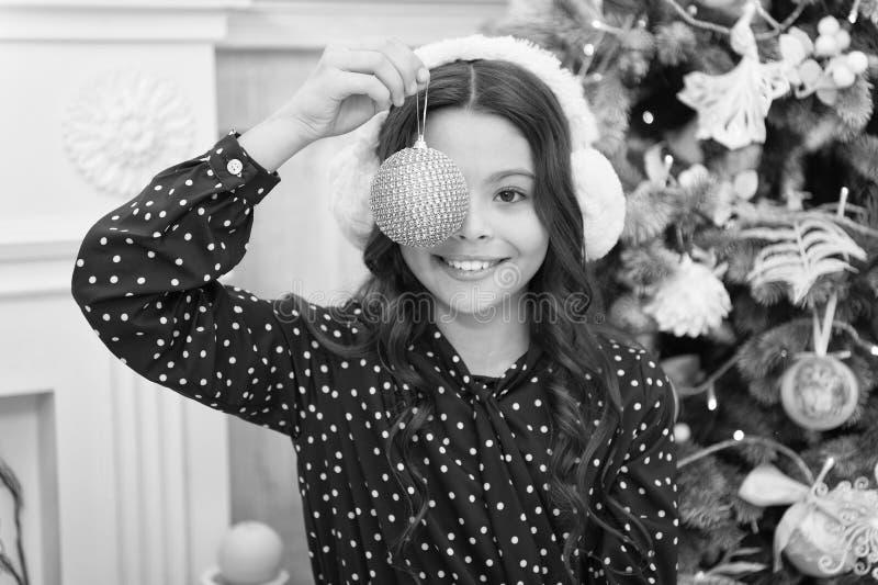 Little child girl likes xmas present. Happy new year. small happy girl at christmas. Christmas. Kid enjoy the holiday. Christmas fun. The morning before Xmas royalty free stock photo