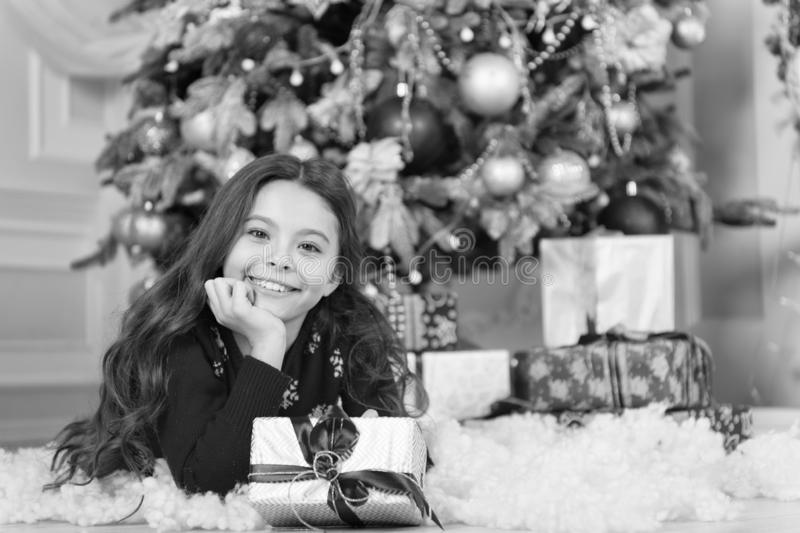 Little child girl likes xmas present. Happy new year. small happy girl at christmas. Christmas. Kid enjoy the holiday. The morning before Xmas. New year royalty free stock images