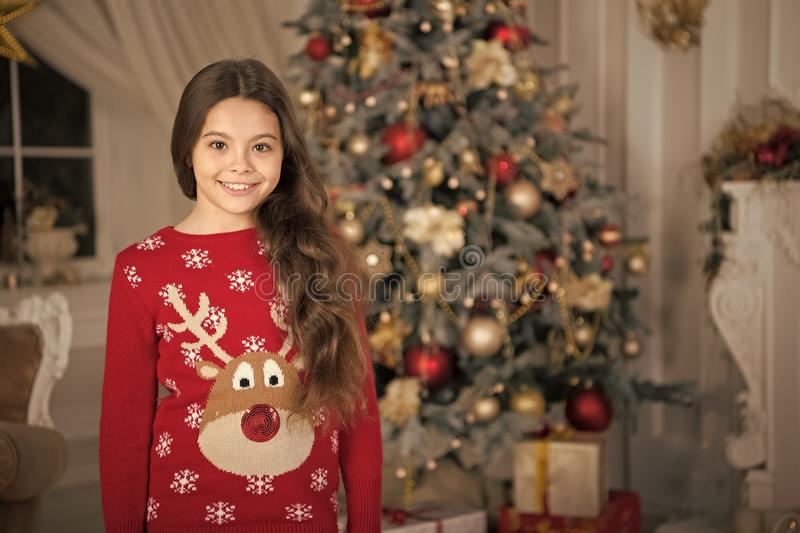 Little child girl likes xmas present. Happy new year. small happy girl at christmas. Christmas. Kid enjoy the holiday. The morning before Xmas. New year stock image