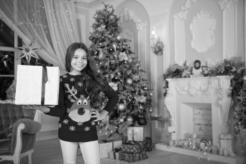 Little child girl likes xmas present. The morning before Xmas. New year holiday. Christmas. Kid enjoy the holiday. Happy. New year. small happy girl at stock image