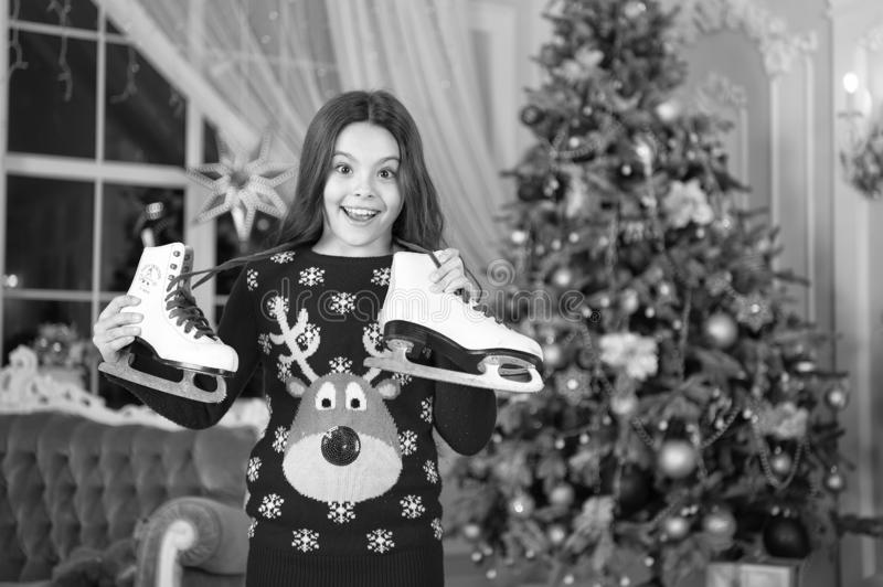 Little child girl likes xmas present. The morning before Xmas. New year holiday. Christmas. girl with skates. winter. Activity. Kid enjoy the holiday. Happy new royalty free stock image
