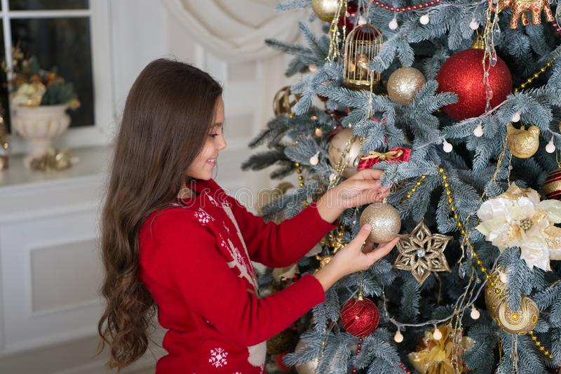 Little child girl likes xmas present. The morning before Xmas. New year holiday. decorate christmas tree. Christmas. Kid. Enjoy the holiday. Happy new year royalty free stock photos