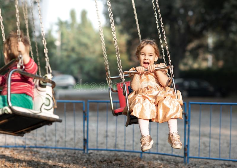 Little Child Girl Playing At Playground Outdoors royalty free stock photos
