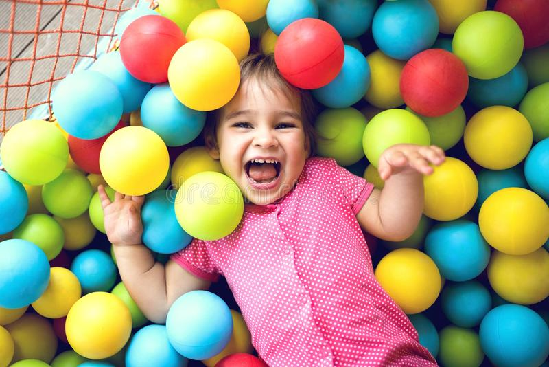Little Child Girl Playing At Playground Outdoors royalty free stock photography