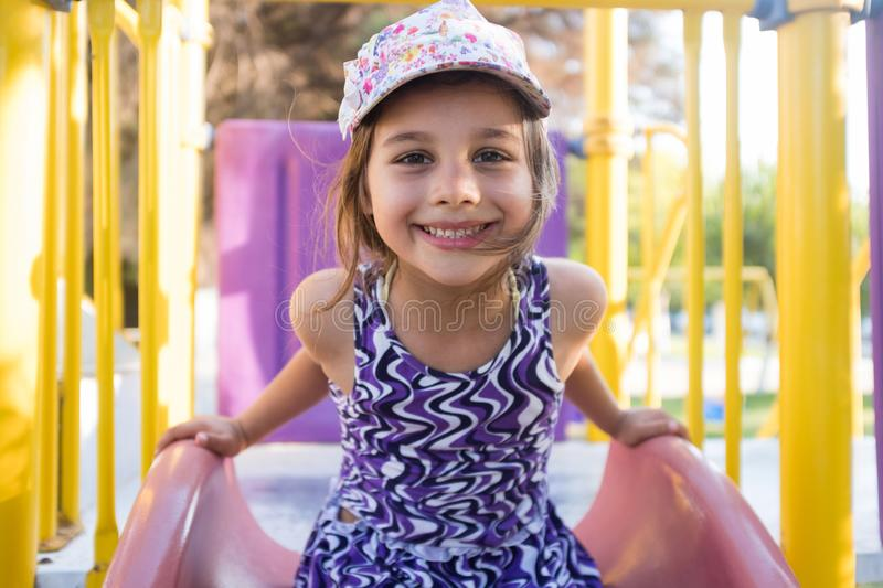 Little Child Girl Playing At Playground Outdoors stock photos