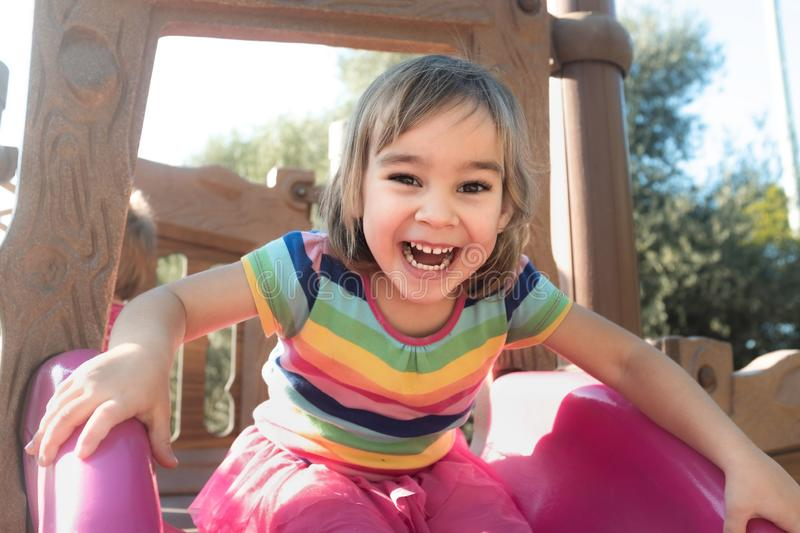 Little Child Girl Playing At Playground Outdoors stock photo