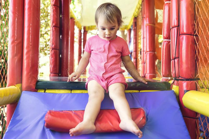 Little Child Girl Playing At Playground Outdoors royalty free stock image