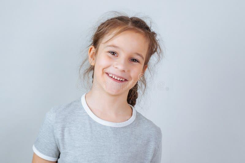 Little child girl posing at studio.Perfect emotional portrait fashion kid. Beautiful face caucasian child 6-7 years stock photography