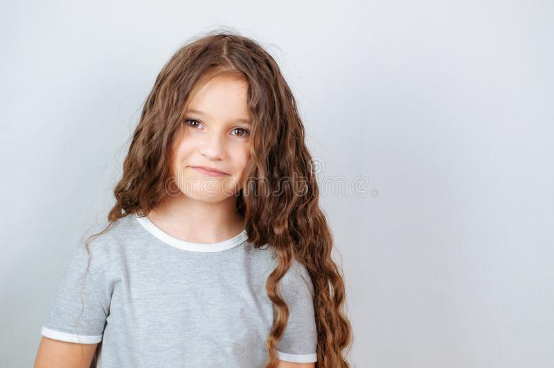 Little child girl posing at studio.Perfect emotional portrait fashion kid. Beautiful face caucasian child 6-7 years. Series of photos smile happy children royalty free stock photography