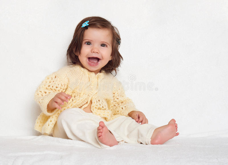 Little child girl sit on white towel, happy emotion and face expression royalty free stock photos