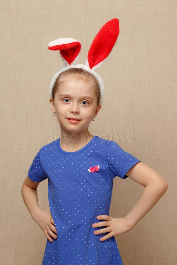 Little child girl wearing bunny ears on Easter day. royalty free stock photo