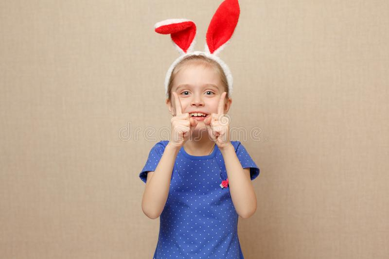 Little child girl wearing bunny ears on Easter day. stock photo