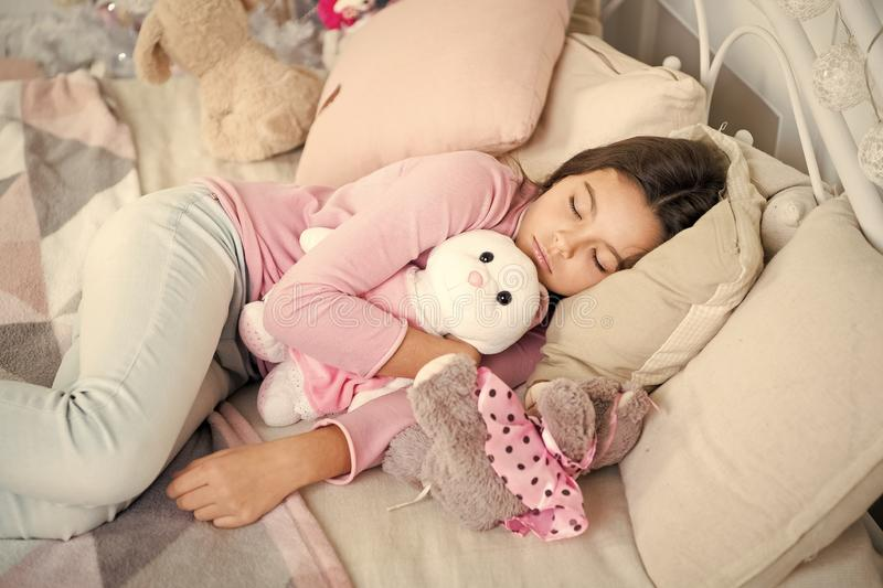 Little child girl with xmas present. happy new year. Christmas shopping. waiting for santa. Winter. small girl sleeping. At home. christmas family holiday stock image