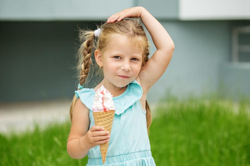 A little child with ice cream. The concept of childhood, lifestyle, food, summer. A little child with ice cream. The concept of childhood, lifestyle, food royalty free stock images