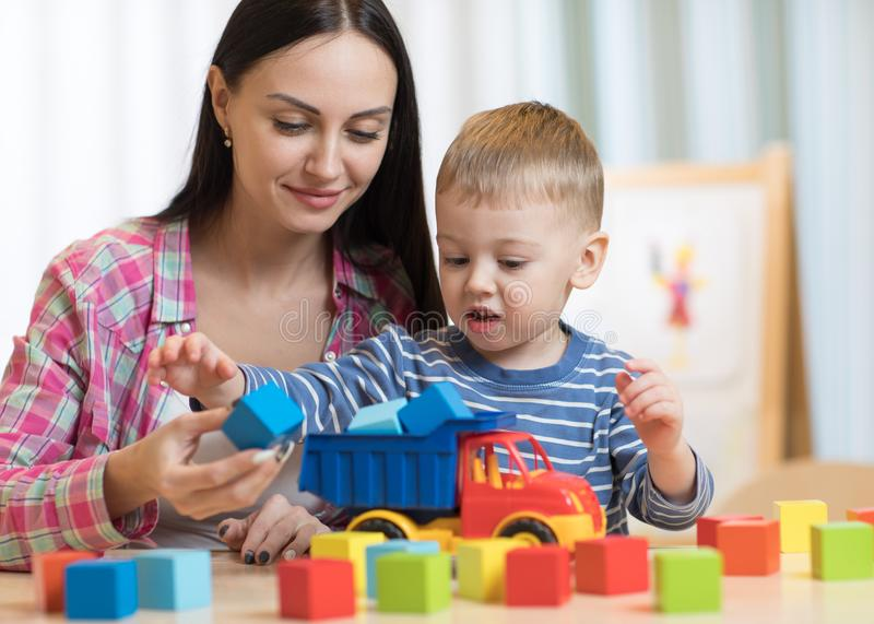Little child kid playing with building blocks stock photography