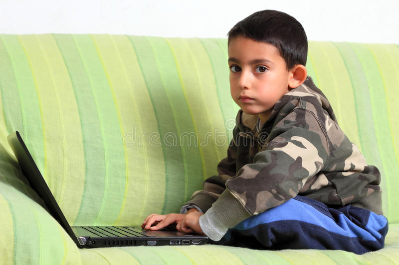 Little Child And Laptop Royalty Free Stock Photo