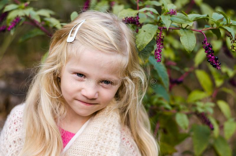 Little child  with long blond hair portrait stock images