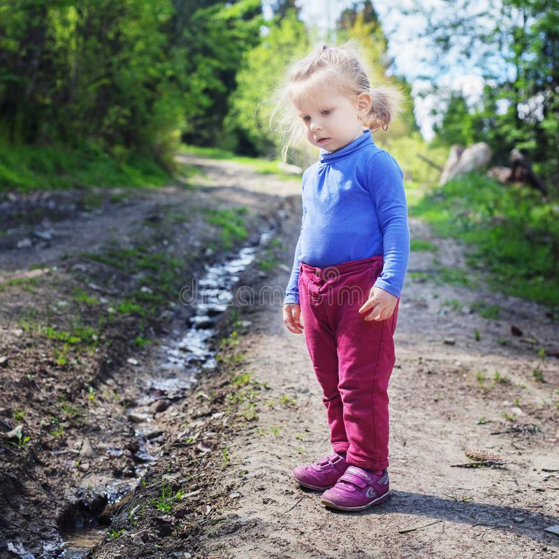 Little child looks at the creek in the woods. Square. Concept fa. Mily, yoga, travel royalty free stock images
