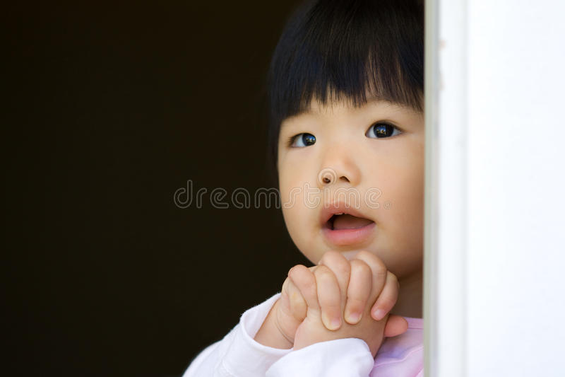 Little child is making a wish royalty free stock photo