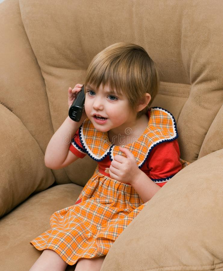 Download The Little Child With Phone Stock Image - Image: 7992663