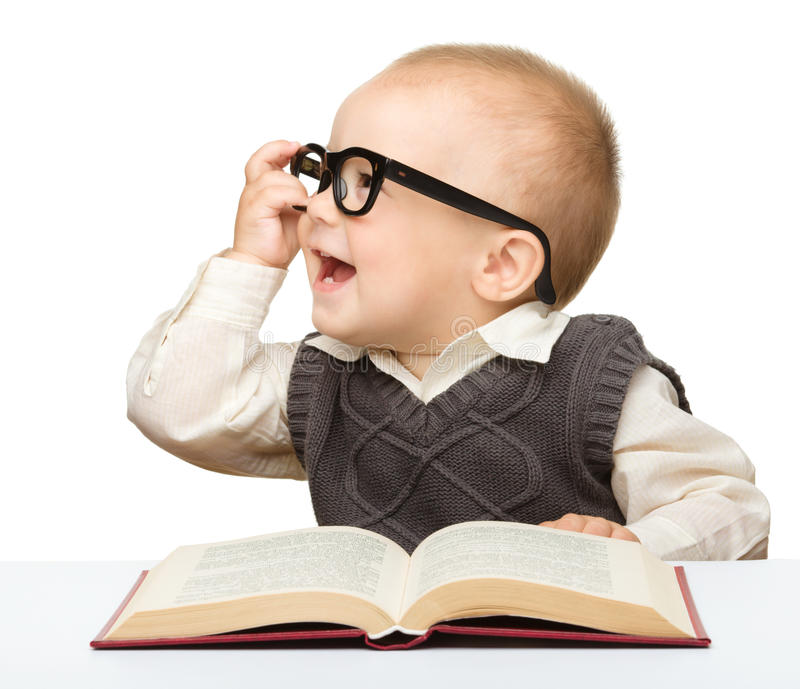 Little Child Play With Book And Glasses Stock Photography