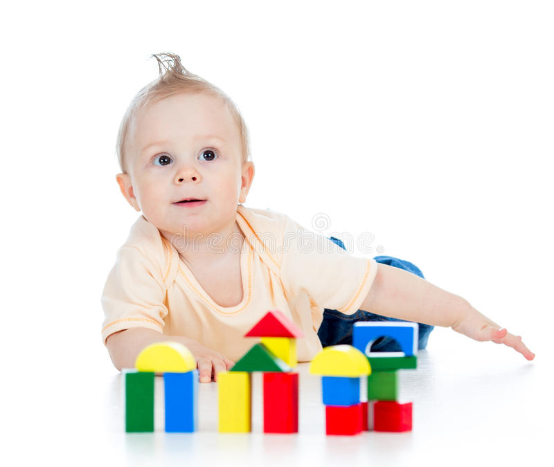 Little child playing with building blocks stock photo