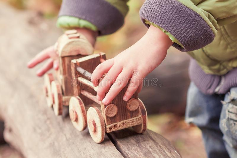 Little child playing a children`s toy train in the park stock images