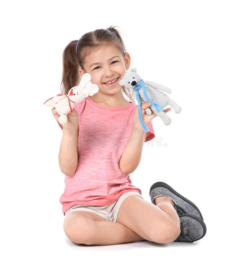 Little child playing with toy animals on. White background. Indoor entertainment royalty free stock photography