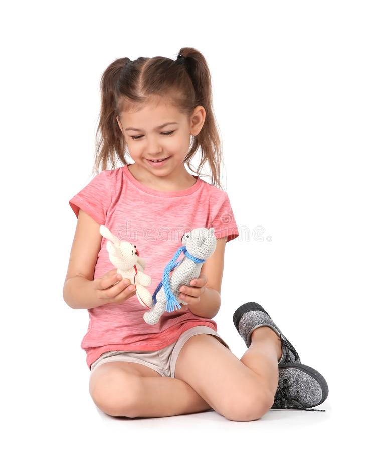 Little child playing with toy animals. On white background. Indoor entertainment royalty free stock images