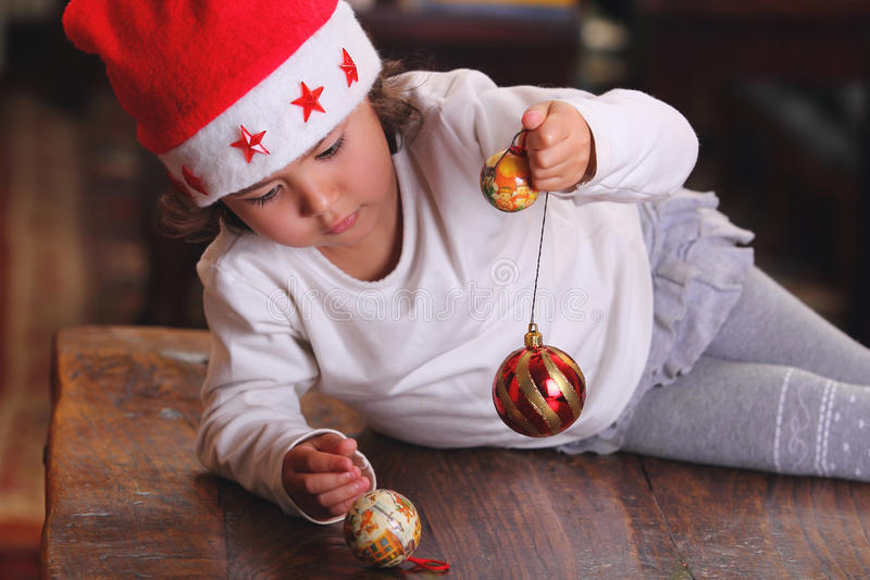 Download Little Child Plays With Xmas Tree Decoration Stock Image - Image: 27556547