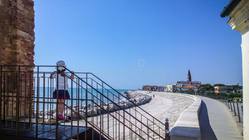 Little child in point of feet to be able to see the panorama from a staircase royalty free stock photography