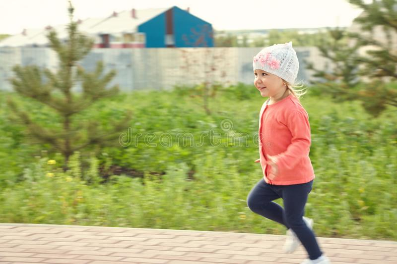 Little child running. Outdoors in the park royalty free stock photos