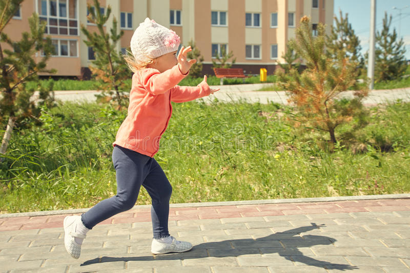Little child running. Outdoors in the park royalty free stock photo