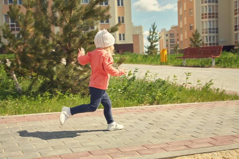 Little child running. Outdoors in the park stock image