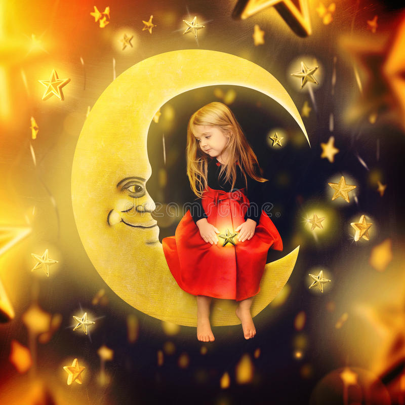 Little Child Sitting on the Moon with Stars. A little girl is sitting on a drawing of a bright moon with falling stars in the background. The child is making a royalty free stock photo