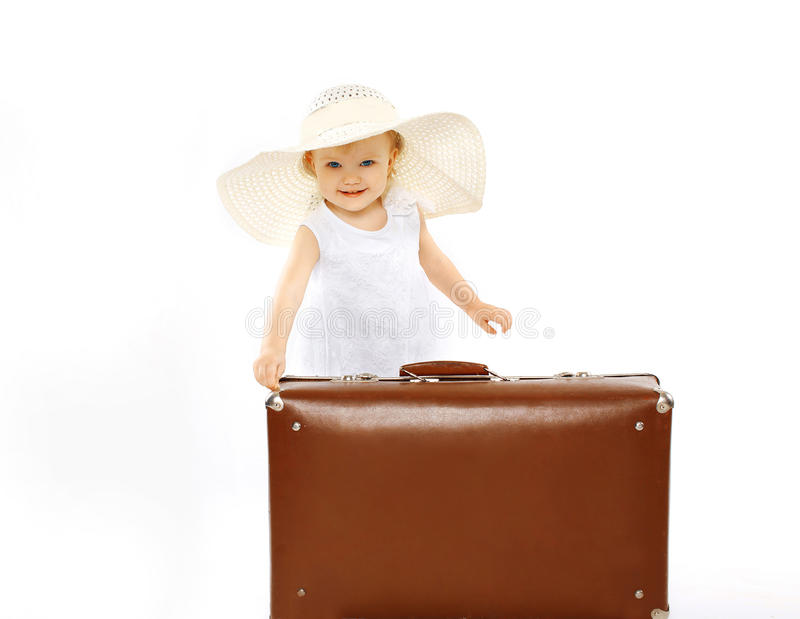 Little child in a straw hat and with suitcase stock photos