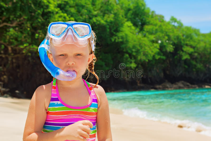 Little child on summer family holidays on tropical beach. Funny little snorkeler on sunny white sand ocean beach. Happy baby have fun, look at surf in tropic stock images