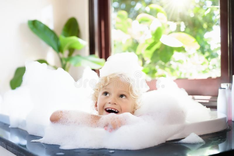 Child In Bubble Bath. Kid Bathing. Baby In Shower. Stock Photo ...