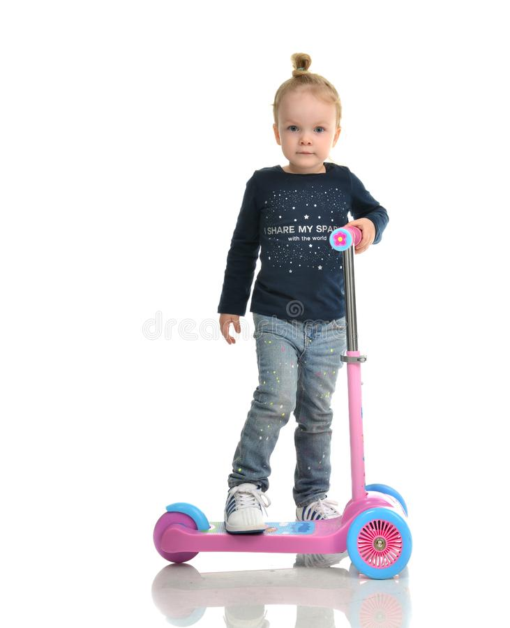 Little child toddler girl learning to ride and balance on push t stock image
