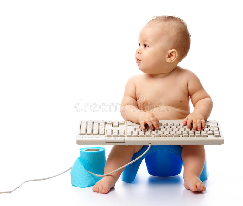 Little child is typing on keyboard royalty free stock photography