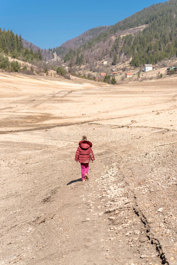 Little child walking in nature. Selective focus royalty free stock photography