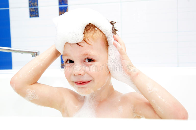 Little child washing his head, taking bath stock images
