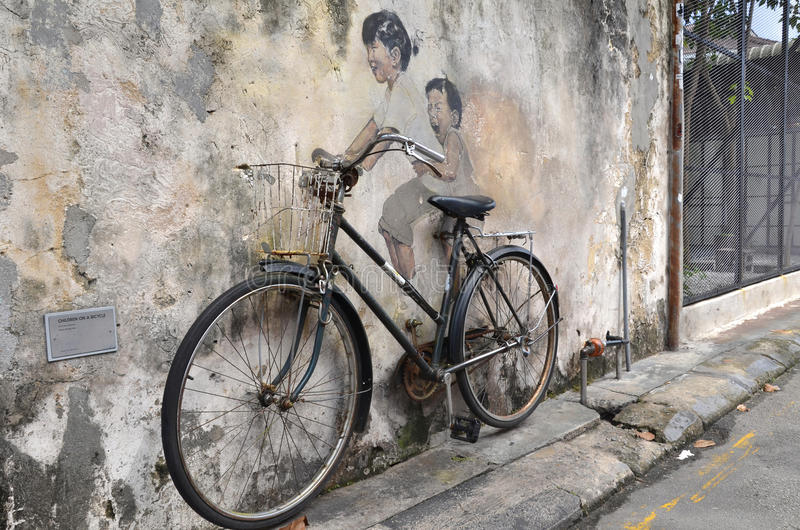 Little Children on a Bicycle street art mural by Lithuanian artist Ernest Zacharevic in Georgetown, Penang, Malaysia. royalty free stock image