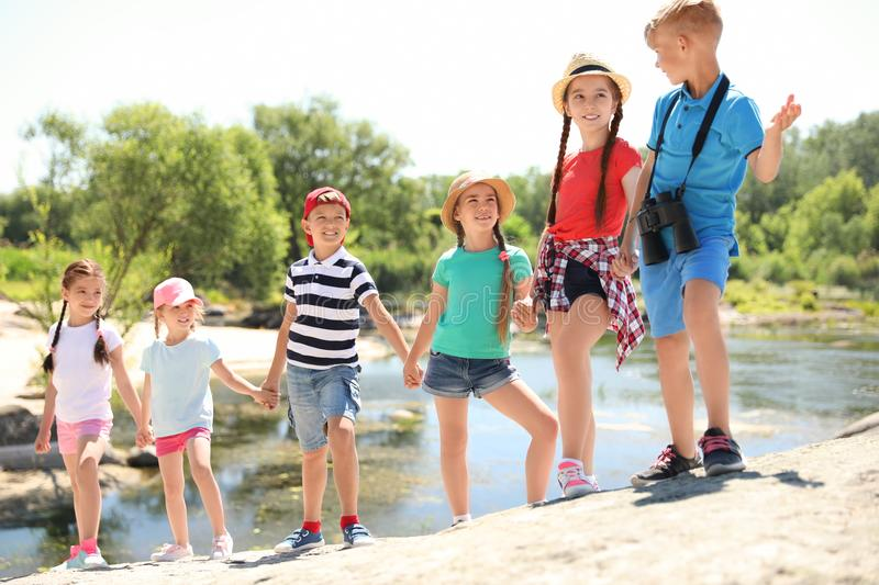 Little children with binoculars outdoors royalty free stock photography