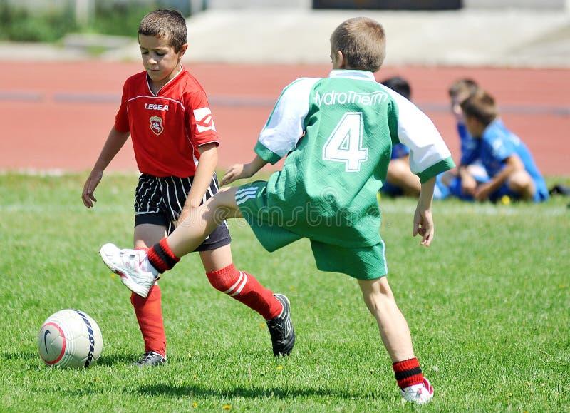 Little children boys play football or soccer stock images